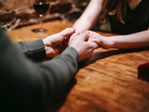 faceless couple having date in restaurant