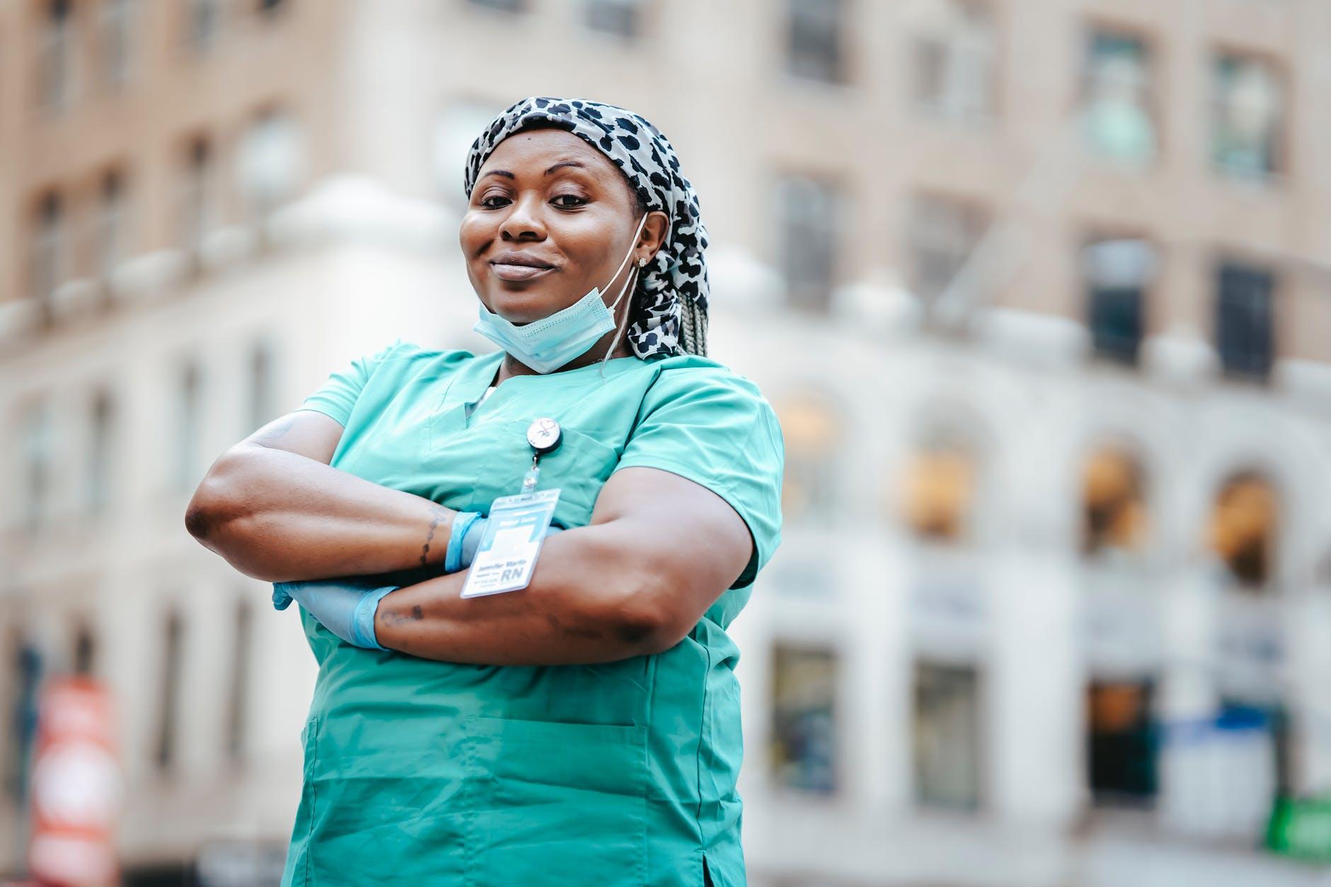black woman in uniform on street